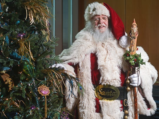 Dressed as Santa Claus, Lyle Kroon, of Sioux Falls,