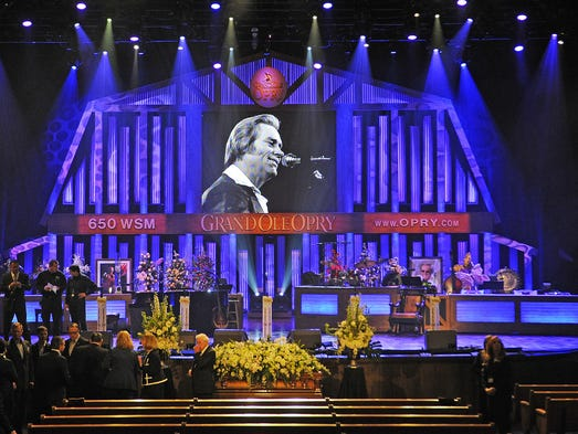 The casket sits alone before the stage before the funeral service for country music legend George Jones at the Grand Ole Opry House in Nashville TN.