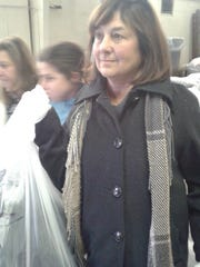 Marcia Moglia grabs a bag of coats for Ladies of Charity