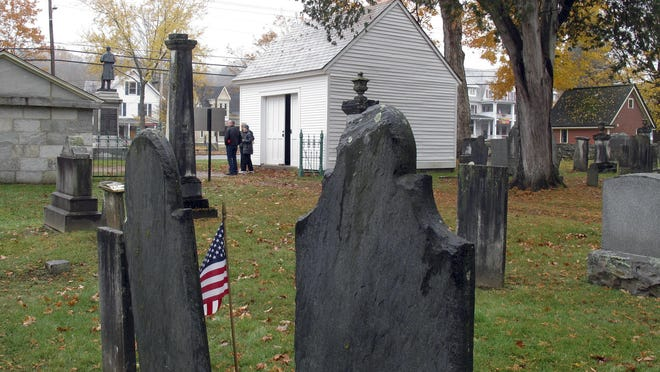 The hearse house, center, and town tomb, left, stand at the entrance to the Brookside Cemetery in Chester. The small town of Chester has restored its 1830s-era hearse house, now home to its last horse-drawn hearse, purchased in 1907.