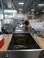 Construction workers install ductwork last week at