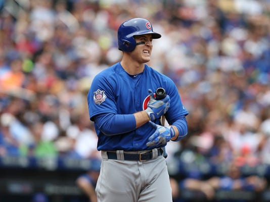 Chicago Cubs' Anthony Rizzo reacts after a strike during the first inning of the baseball game against the New York Mets, Sunday, July 3, 2016, in New York. (AP Photo/Seth Wenig)