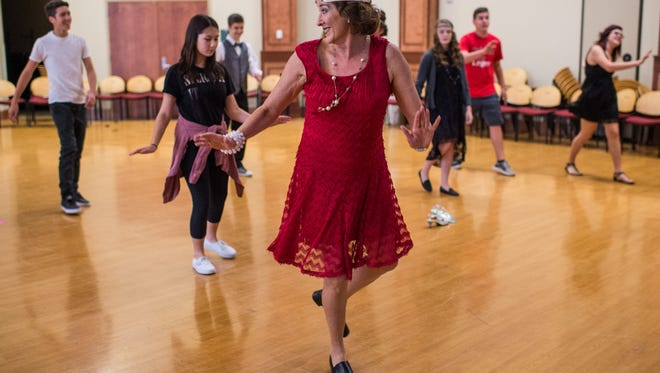 Linda Rome, a health and PE teacher, teaches students how to do the Charleston dance during the Early College Academy's Roaring 20's Symposium at South Louisiana Community College in Lafayette, La., Friday, Oct. 23, 2015.
