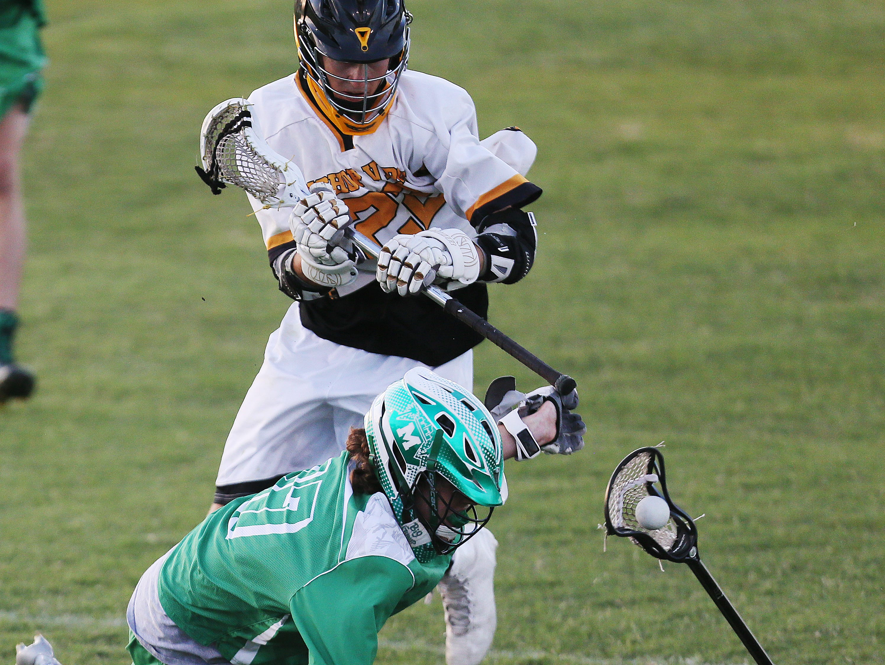 Bishop Verot High School's Luke Lanman, top, defends Fort Myers' Harrison Personnett during the District 18 lacrosse final Friday at the Canterbury School in Fort Myers. Bishop Verot beat Fort Myers 13-6.