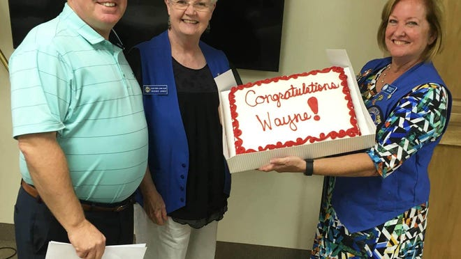 """Glen Rose Lions President Mary Collier (right) and Vice President Deedee Jones presented Glen Rose ISD Superintendent and Lion Wayne Rotan with an """"early"""" retirement cake Wednesday during the Lions Club's August meeting. The Lions and the community expressed their thanks to him for making the GRISD an A-plus rated district and for always thinking of the students first. Rotan previously announced he will be retiring at the end of the year. Rotan speaks to the Lions each year and describes new programs and innovations in the GRISD. This past spring and summer presented new challenges to the district because of the COVID-19 pandemic. The abrupt need to close the schools and develop an online program for all grade levels presented one set of challenges. Preparing a safe environment for schools to reopen this fall presented another set of challenges."""
