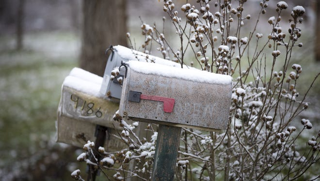 "Mon., April 2, 2018: Nearly two years after eight members of a rural Ohio family were killed, snow covers the mailboxes, on which ""Rhoden"" can still be seen. On the two abutting properties, Frankie Rhoden, his fiancŽ Hannah Hazel Gilley, Frankie's dad Chris Rhoden and Frankie's uncle Gary Rhoden were killed. Also killed were his sister, Hanna Rhoden, his brother, Chris Rhoden, Jr., his uncle, Kenneth Rhoden, and his mom, Dana Rhoden. The Enquirer/Carrie Cochran"