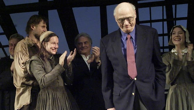 Actors applaud playwright Arthur Miller at the Virginia Theater in New York City on March 7, 2002.