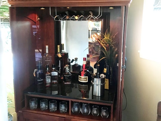 Betty Neuhoff turned her old entertainment center  into a bar for less than $150.