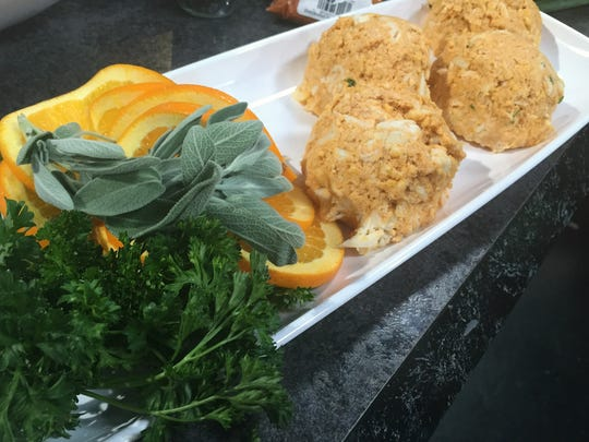 Pumpkin crab cakes ready to go into the skillet. You may also bake these. Garnish them with fresh herbs and orange slices.
