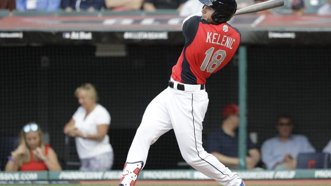 Jarred Kelenic of the Seattle Mariners hits during the MLB All-Star Futures baseball game on July 7, 2019, in Cleveland.