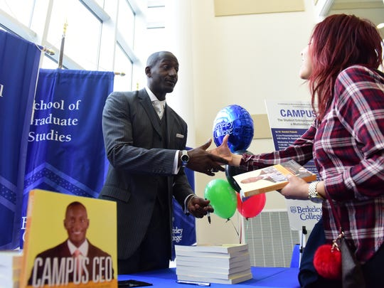 Randal Pinkett, Ph.D, signed copies of his book Campus CEO after speaking at Berkeley College, Woodland Park campus, as its 2017 Black History Month Guest Speaker. Dr. Pinkett lectured students, faculty and guests about ways to obtain an entrepreneur mindset, and share lessons he has learned on his road toward success.  Tariq Zehawi/NorthJersey.com