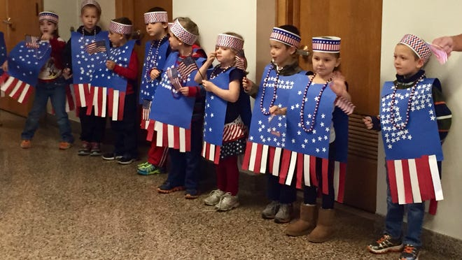Children in Louis Berger's kindergarten classroom at Center Street Elementary School in Horseheads wore handmade flags made of construction paper during the school's annual veterans tribute held Thursday morning.