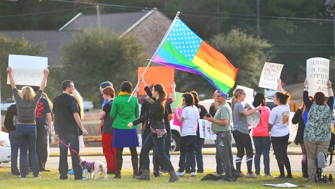 Students, parents and supporters of the proposed gay-straight alliance protest Tuesday at the Rankin County School District offices along U.S. 80 in Brandon. The groups gathered to protest the Rankin County school board's decision to change its policy around school clubs in an attempt to prevent student from forming gay-straight alliances in their schools.