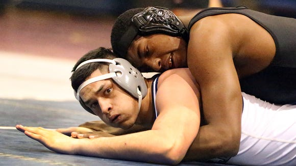 Shawn Boutte, top, of Buena High School in Sierra Vista, Ariz., wrestles with Andres Perez of Del Valle in the boys 182-pound championship match Saturday at the Bowie Wrestling Tournament. Boutte won.