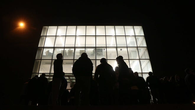 Caucus-goers line up outside of Olin Hall at Drake University in Des Moines on Caucus night on Monday, Feb. 1, 2016.