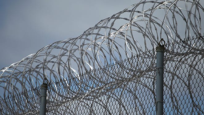 Razor wire tops one of the fences at the Lincoln Hills School for Boys and Copper Lake School for girls complex in rural Irma, Wis. Federal criminal and civil rights investigations probing allegations of abuse of juvenile offenders are underway at the facilities.