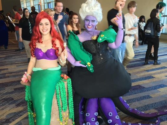 "Mesa friends Diana Thorsen (left) and Sami Nielsen (right) are dressed as Ariel and Ursula from ""The Little Mermaid"" on Day 3 of Phoenix Comic Fest Saturday, May 26, 2018."