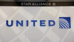 A United Airlines logo is seen behind the ticket counter