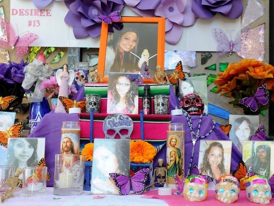 Photos of Desiree Mendez, who died in a car accident at age 23, fill a Dia de los Muertos altar. The public is invited to honor deceased loved ones at a variety of events throughout Ventura County.