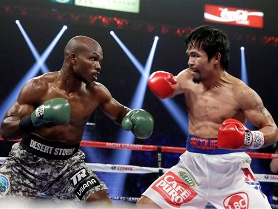 FILE - In this April 12, 2014, file photo, boxers Timothy Bradley, left, trades blows with Manny Pacquiao, of the Philippines, during their WBO welterweight title fight in Las Vegas. Bradley started his boxing career with 31 straight victories before the former two-division champion went 0-1-1 in his last two fights. He looks to get back on a winning track Saturday, June 27, 2015, against unbeaten Jessie Vargas. (AP Photo/Isaac Brekken, File)
