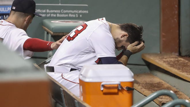 Michael Chavis is consoled by a teammate after ending Tuesday night's game with his fifth strikeout.