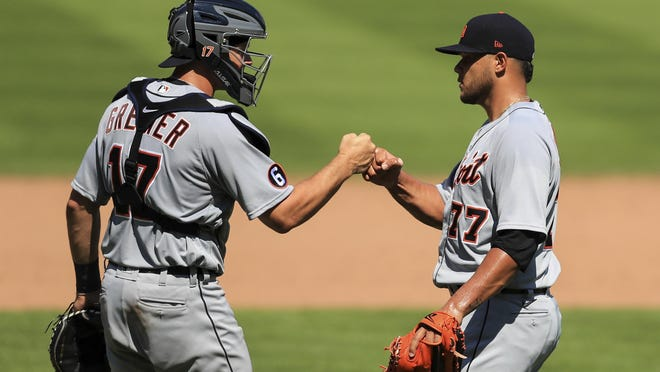 Detroit Tigers' Grayson Greiner (17) celebrates with Joe Jimenez (77) after defeating the Cincinnati Reds in a baseball game at Great American Ballpark in Cincinnati, Sunday, July 26, 2020.