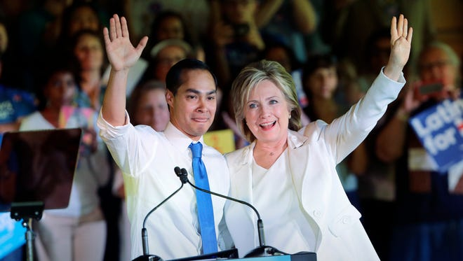 Housing and Urban Development Secretary Julian Castro, left, after introducing Democratic presidential candidate Hillary Rodham Clinton during a campaign event, Thursday, Oct. 15, 2015.