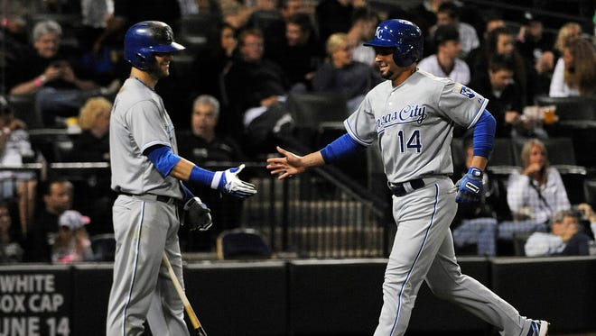 Kansas City Royals second baseman Omar Infante (14) is greeted by left fielder Alex Gordon (4) after scoring against the Chicago White Sox during the seventh inning at U.S Cellular Field.