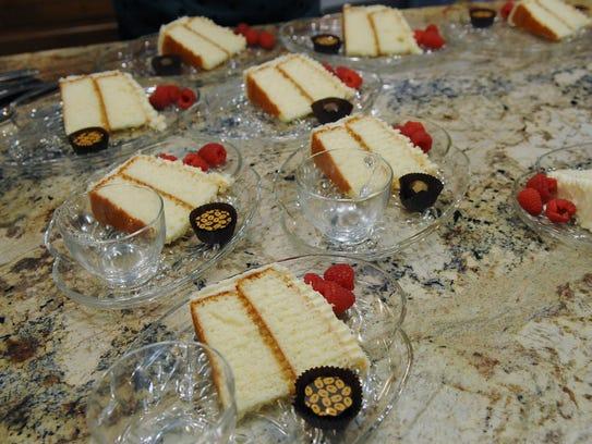 Dessert—Lemon Lovers' White Chocolate Cake--is plated