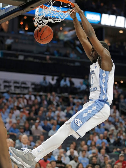 North Carolina's Theo Pinson (1) dunks against Lipscomb during the second half of a first-round game in the NCAA men's college basketball tournament in Charlotte, N.C., Friday, March 16, 2018. (AP Photo/Bob Leverone)