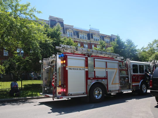 A fire truck sits outside of the complex on Eastman