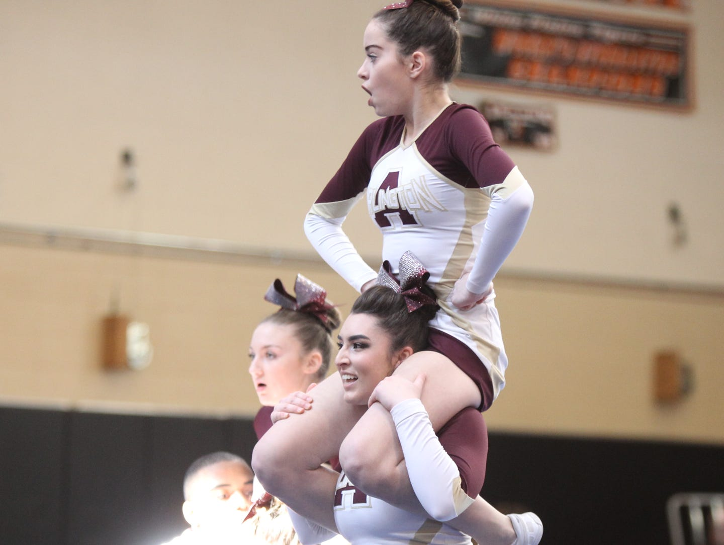 Arlington High School competes in the section 1 cheerleading championships at White Plains High School in White Plains on Saturday, February 18, 2017.