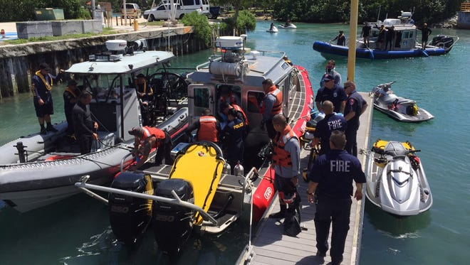 Guam Fire Department personnel transport the recovered body of missing swimmer at Hagåtña boat basin.