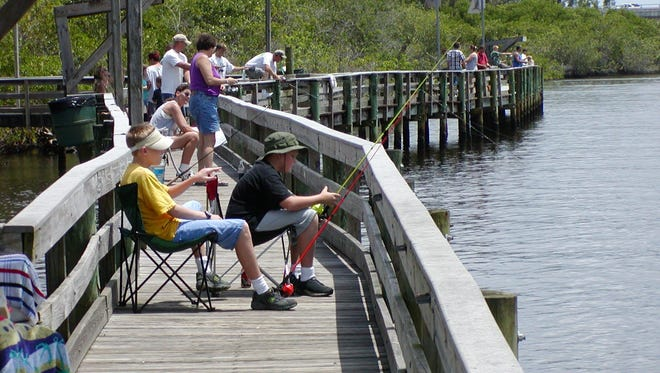 Anglers fish from the Veterans Memorial Park boardwalk in Port St. Lucie in this file photo.