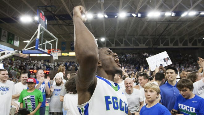 Zach Johnson celebrates after the Eagles defeated Stetson, 80-78, in overtime to advance to the NCAA men's basketball tournament in 2016.
