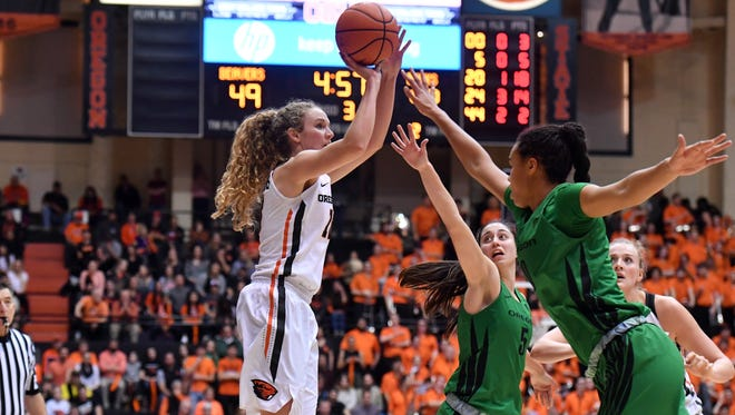 OSU junior guard Katie McWilliams takes a shot during the Civil War game on Friday, Jan. 20 at Gill Coliseum.
