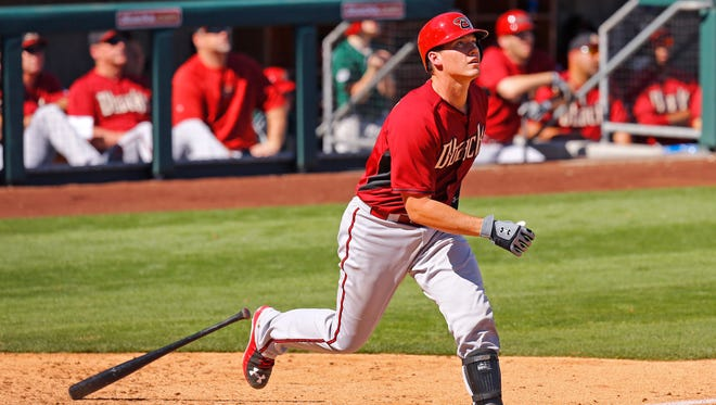 Diamondbacks prospect Peter O'Brien fouls off a ball against Colorado during a spring training game on Wednesday, March 4, 2015 at Salt River Fields at Talking Stick.