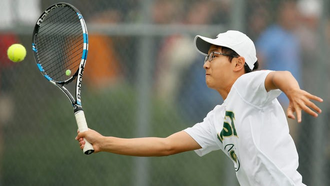 Iowa City West's Jiung Jung returns the ball during a semifinal against Andy Mong of Cedar Falls during the Class 2-A state boys' tennis tournament at Veteran's Memorial Tennis Center.