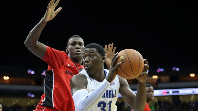 Seton Hall forward Angel Delgado (31) looking to take a shot as Rutgers forward Shaquille Doorson defended during first-half action Friday night in Newark.