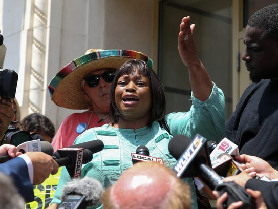 Terina Allen, sister of Sam DuBose, addresses the press