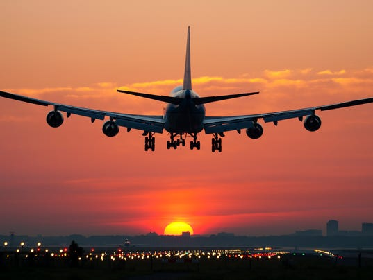 Airplane landing with sunrise