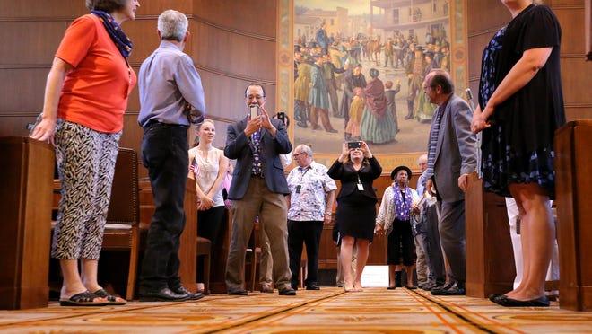 Senators celebrate Sine Die to adjourn the 2015 legislative session at the Oregon Capitol, on Monday, July 6, 2015, in Salem, Ore.