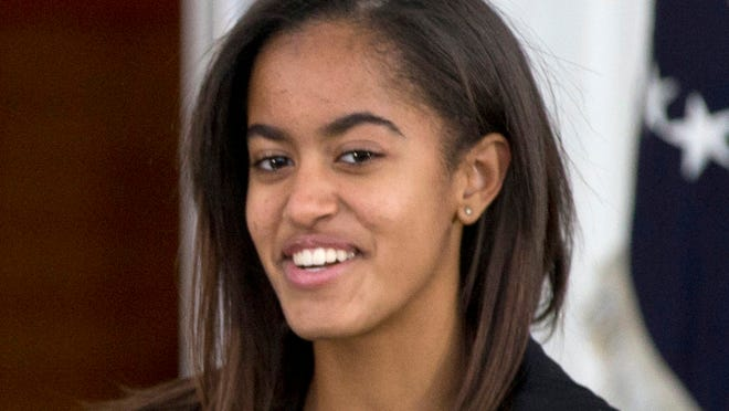 Malia Obama in November 2013. She just attended her first prom but dad won't spill the details.