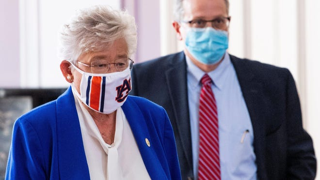 Alabama Governor Kay Ivey and State Health Officer Dr. Scott Harris arrive to announce a statewide mask order during a news conference in the state capitol building in Montgomery on Wednesday.