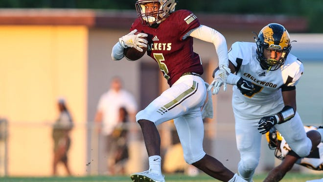 St. Augustine wide receiver Dequan Stanley (5) returns a kick off during the first quarter of a high school football game against Englewood during a Sept. 27, 2019 contest. Stanley committed to Bowling Green on June 8.