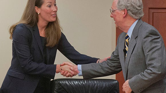 """Kentucky Secretary of State Alison Lundergan Grimes shakes hands with U.S. Sen. Mitch McConnell after debating him as part of the Kentucky Farm Bureau''s """"Measure the Candidates"""" forum at the KFB headquarters in Louisville. 20 August 2014"""