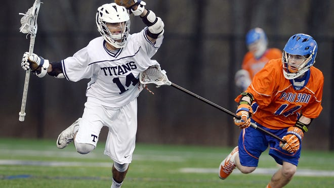 Webster Thomas' Sammy Botross-Greenlee, left, is defended by Penn Yan's John Luppino during a regular season game played at Thursday. Webster Thomas beat Penn Yan 8-7.