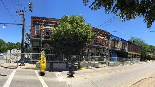 Scaffolding and fencing now surround two buildings in Loveland's historic district that were gutted by fire over the  Memorial Day weekend.