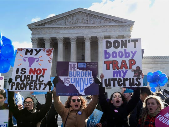 Pro-abortion rights protesters rally outside the Supreme