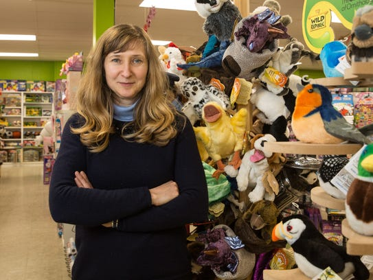 World of Toys owner Olga Kozhevnikova poses for a photo